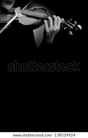 Violin orchestra music violinist with instrument concert playing - stock photo