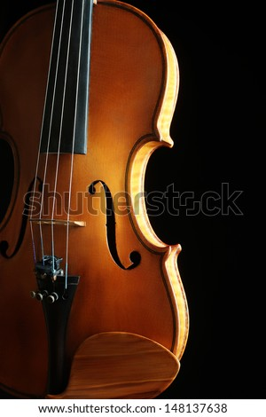 Violin orchestra musical instrument closeup on black