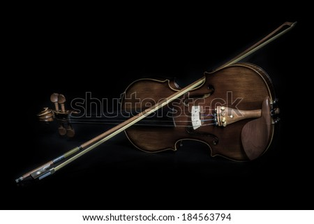 Violin orchestra musical instruments isolated on black. Classical music instrument