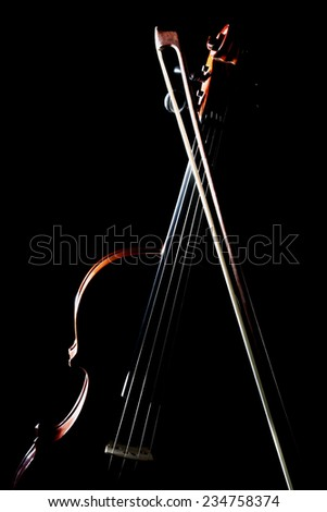 Violin orchestra musical instruments on black background isolated with bow - stock photo