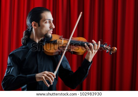Violin player playing the intstrument - stock photo