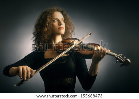 Violin player violinist classical music playing. Orchestra musical instruments