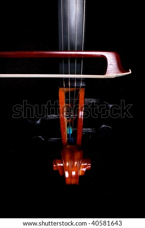 Violin strings and tuners with bow - stock photo