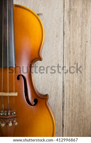 violin unplugged music instrument with wood background