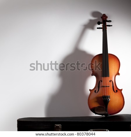 Violin with soft shadow and copy space - stock photo