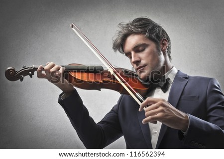 Violinist playing a violin - stock photo