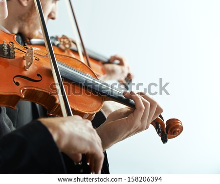 Violinist playing at the concert, hands close up - stock photo