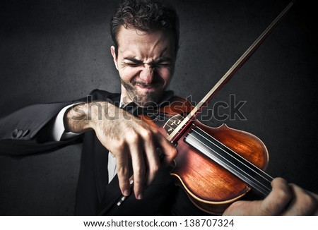 violinist playing violin - stock photo