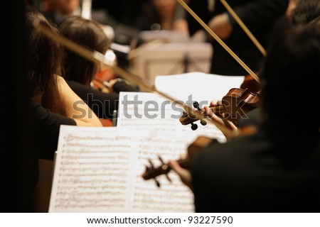 violinists during a classical concert music - stock photo
