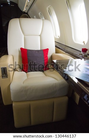 VIP Business Jet Interior with leather chair