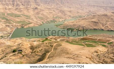 Virew on the Mujib Dam located in Wadi Mujib, between the cities of Madaba and Kerak, in the Madaba Governorate of Jordan. - stock photo