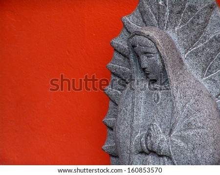 Virgen de Guadalupe carved in stone                             - stock photo