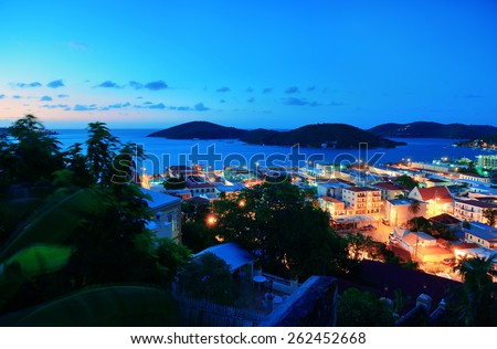 Virgin Islands St Thomas mountain view in early morning with buildings and beach coastline.  - stock photo