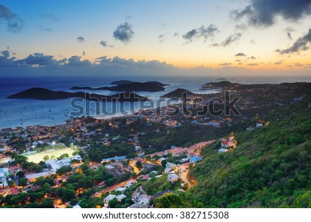 Virgin Islands St Thomas sunset mountain view with colorful cloud, buildings and beach coastline.  - stock photo