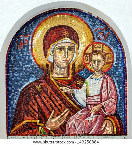 Virgin Mary - mosaic icon in rocky Serbian Orthodox Christian monastery Ostrog in mountains, Montenegro. Ostrog - popular place of pilgrimage in Europe. - stock photo