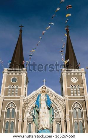 Virgin Mary statue in front the old catholic church, Chantaburi province, Thailand. - stock photo