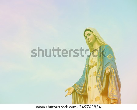 Virgin mary statue with blue sky background the most beautiful statue in Thailand vintage tone - stock photo