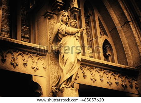 Virgin Mary with baby Jesus above Entrance Door of St. Nicholas Roman Catholic Cathedral, Kiev, Ukraine