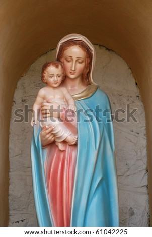Virgin Mary with baby Jesus in her arms - stock photo