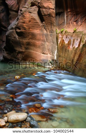 Virgin River flows through The Narrows of Zion National Park in southwestern Utah - stock photo