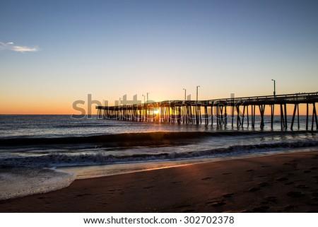 Virginia Beach Fishing Pier at Sunrise  - stock photo