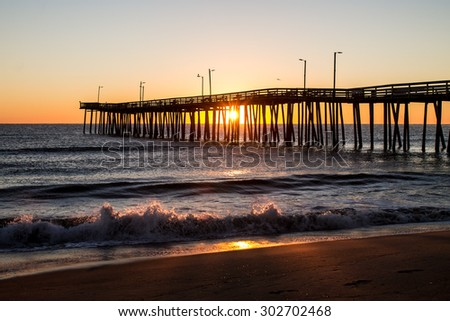 Virginia Beach Fishing Pier at Sunrise and waves - stock photo