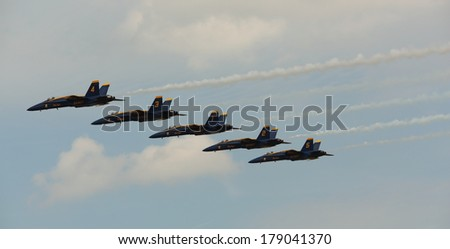 VIRGINIA BEACH, VA - May 17:US Navy Blue Angels in F-18 Hornet planes perform in air show routine in Va beach, VA on May 17, 2010. Blue Angels are the oldest active aerobatic team in the world - stock photo