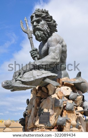 VIRGINIA BEACH, VA - SEP 11: King Neptune Statue at the entrance of Neptune Park on the Virginia Beach boardwalk, as seen on Sep 11, 2015. The  sculpture weighs 12.5 tons and stands 34-feet tall. - stock photo