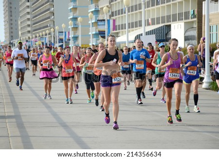 VIRGINIA BEACH, VIRGINIA - AUGUST 31: Runners compete in the Rock N Roll Virginia Beach 1/2 Marathon in Virginia Beach, Virginia August 31, 2014 - stock photo