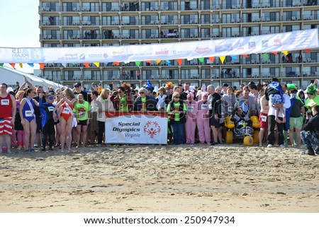 VIRGINIA BEACH, VIRGINIA  FEBRUARY 7: Special Olympics participants wait on the beach for the Polar Plunge Winter Festival in Virginia Beach, Virginia February 7, 2015 - stock photo