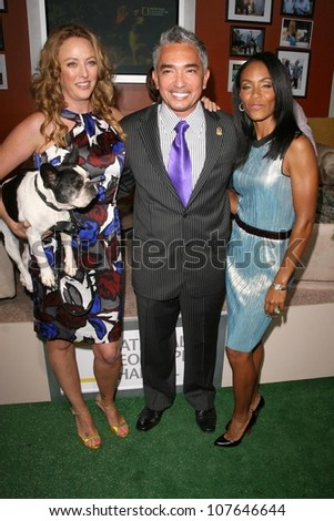 Virginia Madsen with Cesar Millan and Jada Pinkett Smith  at the party to celebrate the 100th Episode of 'Dog Whisperer'. Boulevard 3, Hollywood, CA. 09-17-08 - stock photo