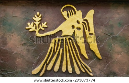 Virgo sign of horoscope on the wall - stock photo