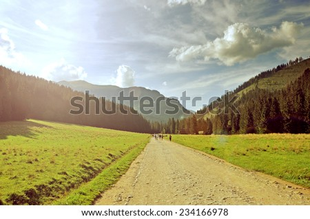 Virtage photo of mountain road - stock photo