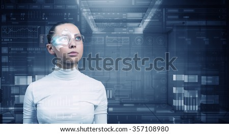 Virtual holographic interface and young woman wearing glasses - stock photo