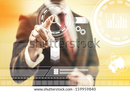 Virtual interface concept man pointing and selecting - stock photo