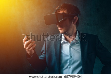 Virtual reality and futuristic technology in modern business, businessman with VR headset and smartphone using new tech gadgets to develope and manage entrepreneurship