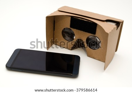 Virtual reality cardboard glasses. Easy way to watch movies and play games in 3D - stock photo
