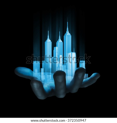 Virtual reality city / 3D render of miniature holographic city in human hand