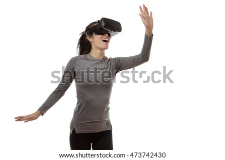 virtual reality fitness woman looking at the world before her eyes