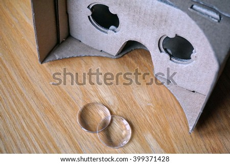 Virtual reality headset (eye-wear) with the optical lenses separated from the cardboard head equipment