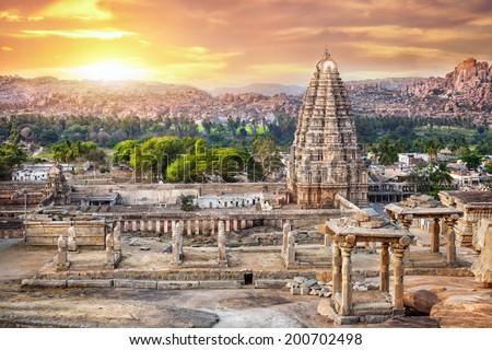 Virupaksha temple view from Hemakuta hill at sunset in Hampi, Karnataka, India - stock photo
