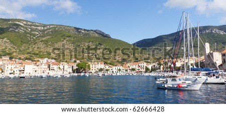 VIS ISLAND, CROATIA - OCTOBER 8: Panoramic View of Komiza Cove on the Adriatic Sea on October 8, 2010 on Vis Island, Croatia - stock photo