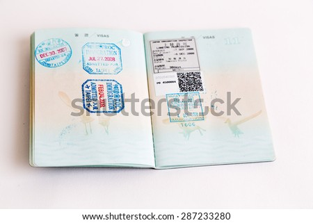 Visa and customs stamps in passports - stock photo