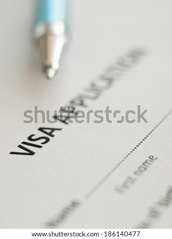 VIsa application form with pen, shallow DOF,for immigration,travel,social issues themes