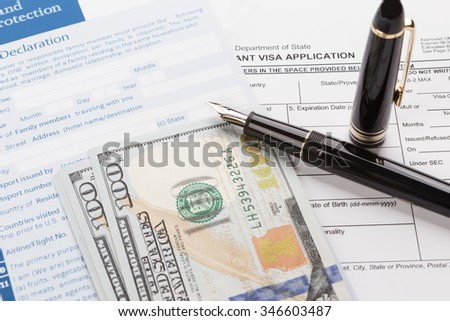 visa application with customs declaration and fountain pen