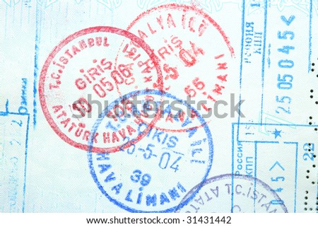 Visa entry and exit stamps in a passport.