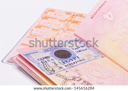 visa in the passport of the border crossing - stock photo