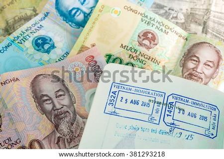 Visa passport stamp from vietnam and Vietnamese money (Dong) - stock photo