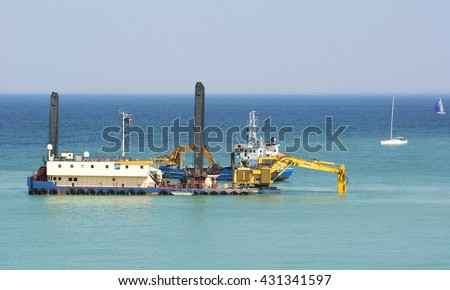 Visby, Sweden - April 2016 : Dredging the ocean floor outside Visby harbor to start build a new pier for cruising ships on the island of Gotland in the Baltic sea in Sweden