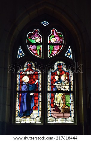 VISE, BELGIUM-JULY 07, 2014: Stained glass window in Collegiale Saint-Martin and Saint-Hadelin or church of Saint-Martin of Vise. The history of the church starts from 1338